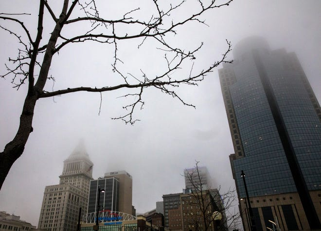 Many of the buildings in downtown Cincinnati were hidden by the heavy fog Wednesday morning, March 17, 2021. Though clouds would stick around most of the day for St. Patrick's Day, the temperatures were in the high 60's.