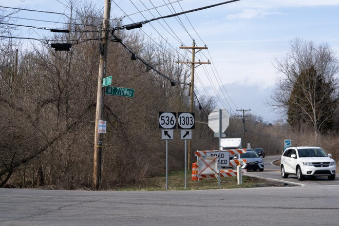 Unmarked graves in the woods cause issue for the construction of a new intersection, Tuesday, March 16, 2021 at the intersection of Mt. Zion Road and Bristow Road in Kenton County, Kentucky.