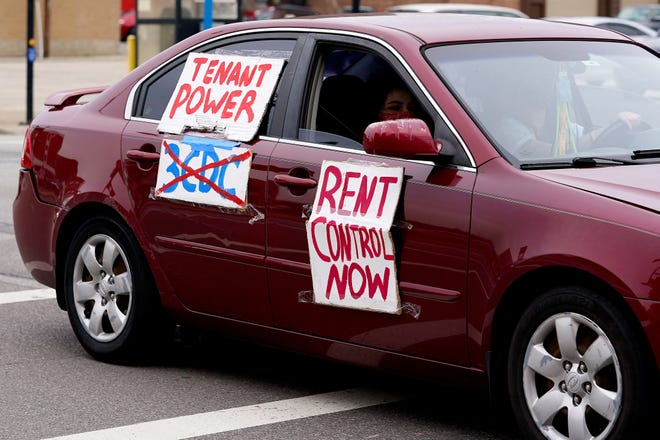 A line of about a dozen cars participating in a caravan around Cincinnati City Hall in support of the affordable housing amendment, which would invest $50 million or more every year for affordable housing, Wednesday, March 17, 2021.