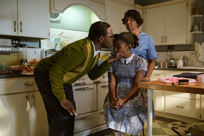 "In ""Genius: Aretha,"" grandmother Rachel Franklin (background), played by Pauletta Washington, stands by as C.L. Franklin (left), played by Courtney B. Vance, comforts his daughter Aretha Franklin, played by Shaian Jordan as Little Re."