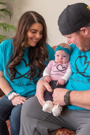 Jackie, Ricky and baby Mia Rose Dennis. Jackie Dennis is Michigan's first recipient of a double-lung transplant due to irreparable damage to her lungs after contracting COVID-19.