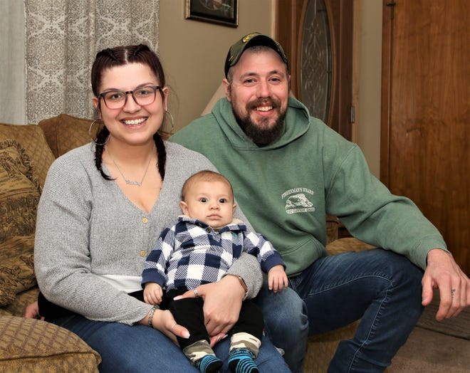 Lesha Lu Dinan of Green Springs. along with her son  Rollyn and his father, Zac Long.