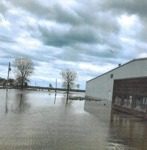 Flood waters surround the steel building at the tip of Fisherman's Point in the Kewaunee harbor last year. It's one of three blighted properties the city of Kewaunee acquired under a Community Development Block Grant to raze the building and improve the property for redevelopment, including raising the ground level to help prevent future floods.