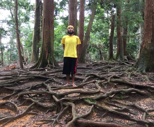 Allen Manglona on day 143 of the fruitarian diet, hiking up Mount Kurama in Kyoto, Japan.