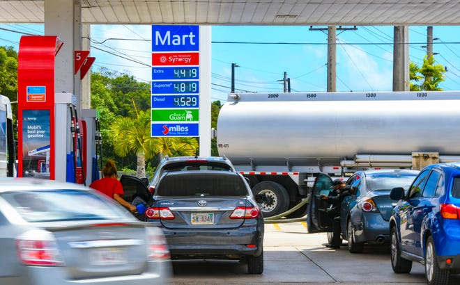 The latest increase in gasoline prices are displayed outside the Mobil refueling station as a tanker truck prepares to refill underground storage tanks at the corner of Marine Corps Drive and Fatima Street in Dededo on Wednesday, March 17, 2021. The previous price hike to $4.30 per gallon for regular fuel was on March 1, according to Pacific Daily News files. This increase by 12 cents per gallon at local Mobil stations are historically mirrored by other brand stations within the following 24 hours.
