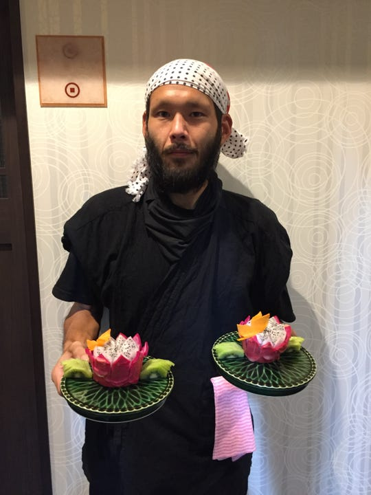 """Allen Manglona from Tinian works at a restaurant called """"Kakomi"""" in Yokkaichi, Japan. He makes fruit art for the customers."""