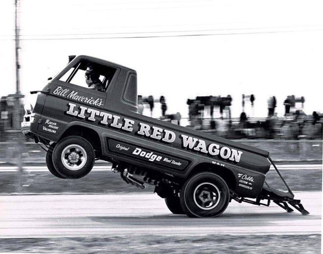 """The world famous Little Red Wagon exhibition dragster depicted with the paint job done by Cobb's Custom Body Shop of Henderson in 1971. If you look closely you can see the Cobb logo and """"Henderson, Ky."""" painted on the rear quarter-panel."""