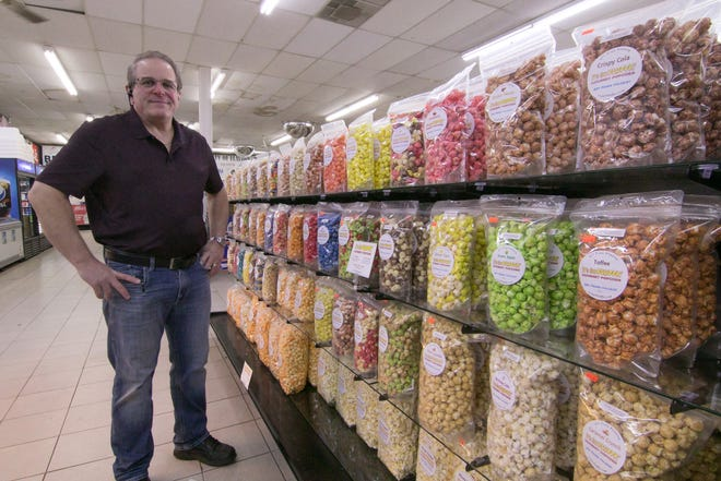 Hamburg Township resident Stephen Canale, who launched It's So Fluffy flavored popcorn and Floating Cotton Candy, makes and sells the popcorn at Genoa Township's Middletown Market. Canale stands by the wide selection of his gourmet popcorn in Middletown Market Wednesday, March 17, 2021.