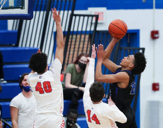 Eastern's Christian Spalding (23) shot against Christian Academy of Louisville defenders during their game at the Eastern High School in Louisville, Ky. on Mar. 16, 2021.  Spalding scored 27 points as Eastern won 68-48.