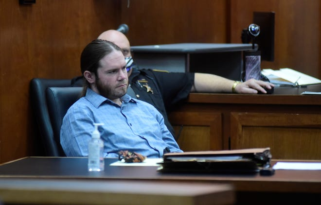Aaron Blystone listens to opening arguments during the second day of his rape trial in Richland County Common Pleas Court.