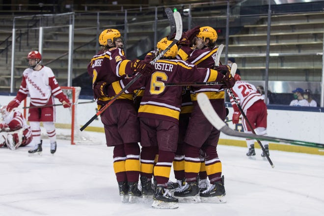 Minnesota players celebrate a goal against Wisconsin during the championship game of the Big Ten hockey tournament.