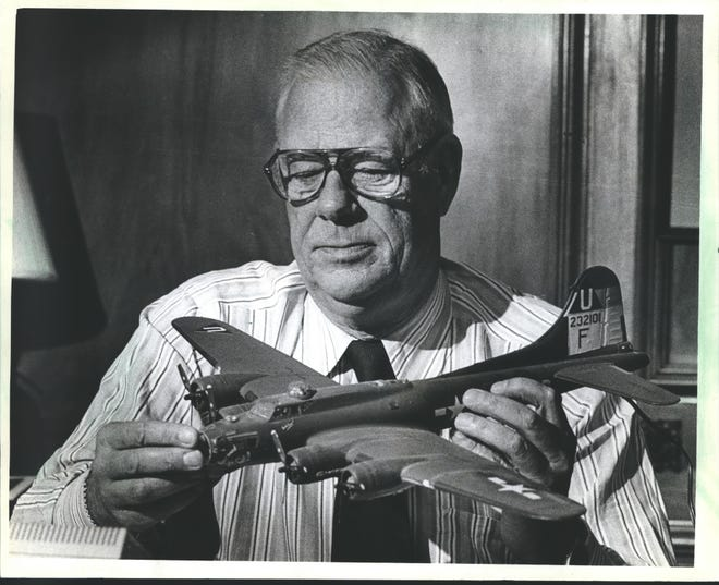 Francis E. Ferguson held a model of a B-17F Flying Fortress that his son-in-law made for him.  Ferguson was a B-17 pilot during World War II.