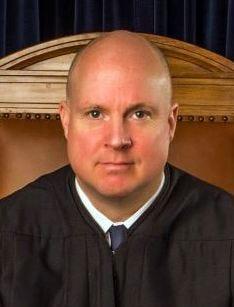 Justice Thomson