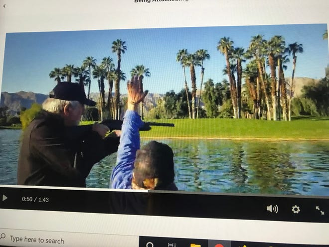 A screenshot shows an animal rights activist attempting to stop a member of the S at Rancho Mirage from shooting birds on March 4.
