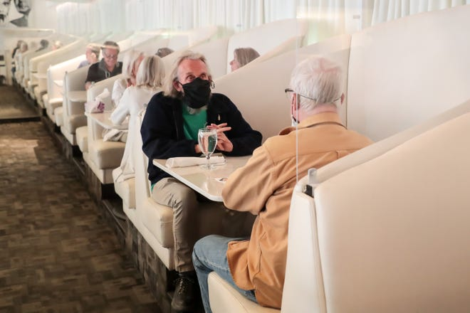 Diners sit inside at Lulu California Bistro, in Palm Springs, Calif., on Wednesday, March 17, 2021, the first day of red tier status for Riverside County.
