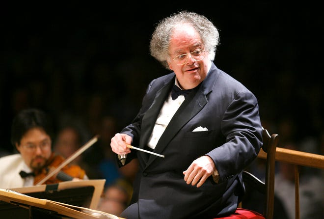 FILE - Boston Symphony Orchestra music director James Levine conducts the symphony on its opening night performance at Tanglewood in Lenox, Mass. on July 7, 2006. Levine, who ruled over the Metropolitan Opera for 4 1/2 decades before being eased out when his health declined and then fired for sexual improprieties, died March 9, 2021 in Palm Springs, Calif., of natural causes, his physician of 17 years, Dr. Len Horovitz, said Wednesday, March 17. He was 77. (AP Photo/Michael Dwyer, File)