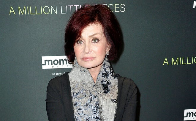 "FILE - Sharon Osbourne attends a special screening of ""A Million Little Pieces"" on Dec. 4, 2019, in Los Angeles. CBS says its daytime show ""The Talk"" will stay on hiatus for another week after a discussion about racism involving co-host Sharon Osbourne went off the rails last week. Osbourne reacted with anger and profanity when asked to talk about her support and friendship with British TV personality Piers Morgan. (Photo by Richard Shotwell/Invision/AP, File)"