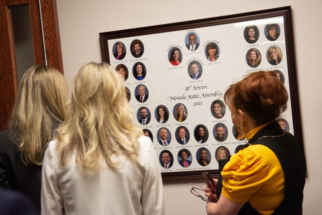 Members of the Assembly stop and look at the recently hung 2021 photo inside the Legislature on Monday, March 15, 2021 in Carson City, Nev.