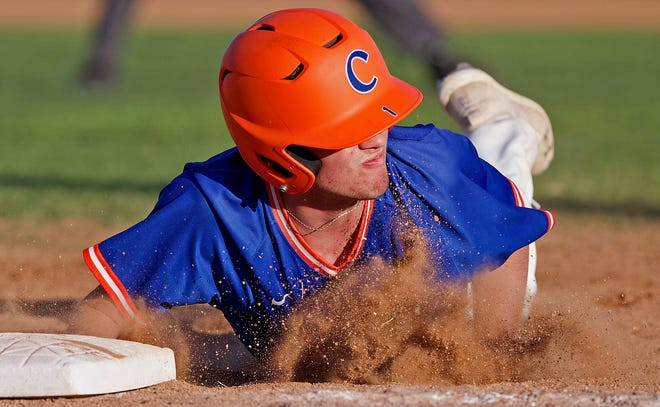 Cayden Box dives back to first base for Central during a game against Midland on Tuesday, March 16, 2021.