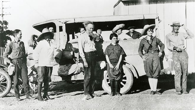 """Frank Reaugh (center) with students and his customized Model T Ford touring vehicle """"Cicada,"""" ca. 1920s. Photograph: reproduction. 29 x 36 x 3 cm. The Jerry Bywaters Collection on Art of the Southwest, The Jake and Nancy Hamon Arts Library, Southern Methodist University, Dallas, Texas."""