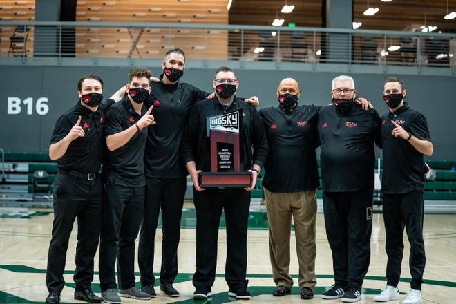 SUU coach Todd Simon (center) and his staff celebrate the 2020-2021 Big Sky regular season championship.