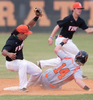 Florida A&M University infielder Octavien Moyer (15) makes a catch as a Mercer runner slides into second base during a game between FAMU and Mercer University Tuesday, March 16, 2021.