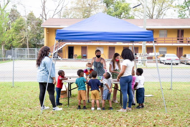 """A group of around 20 children attended a """"popup preschool"""" facilitated by three local women in the Greater Bond and South City communities Wednesday, March 17, 2021."""