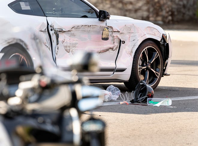 Visalia Police investigate a three-vehicle collision Tuesday, March 16, 2021 that killed a motorcycle driver. All there were northbound on Ben Maddox near Buena Vista when the collision occurred with the motorcycle between a Mustang and a Jeep. Ben Maddox Way was closed between Houston Avenue and St. Johns Parkway while police investigated.