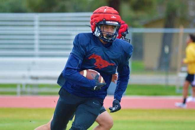 The Tulare Western High School football team practices on March 15, 2021 in Tulare.