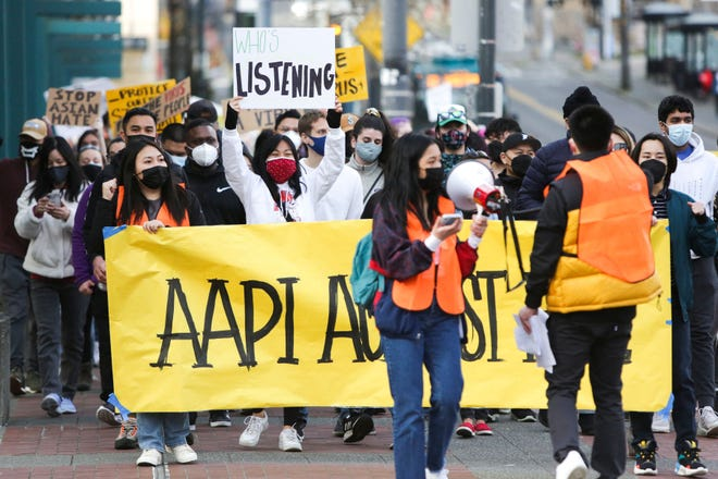 "People march during the ""We Are Not Silent"" rally against anti-Asian hate in response to recent anti-Asian crime in the Chinatown-International District of Seattle, Washington on March 13, 2021."