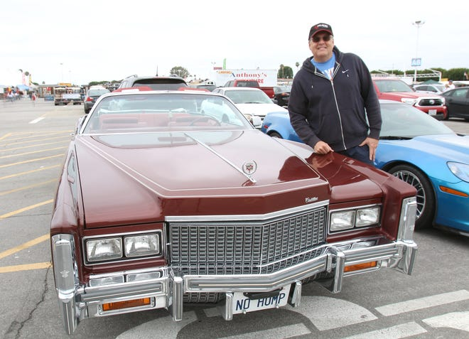 James Daurio poses with his 1976 Cadillac Eldorado at the Cars and Coffee car gathering in Costa Mesa, California, on May 14, 2016.