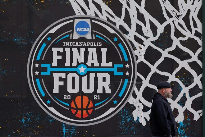 The Final Four logo for the NCAA men's tournament is painted on a window in downtown Indianapolis.