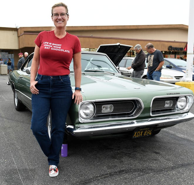 Maria Shrout with her classic Plymouth Barracuda at a car show in Huntington Beach, California, on June 10, 2017.