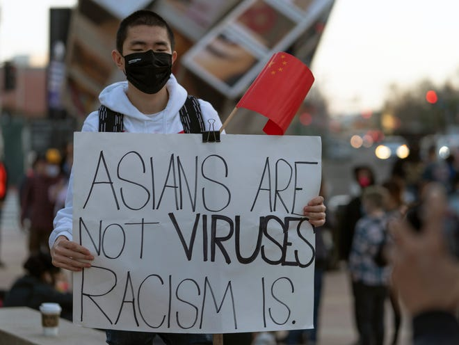 Demonstrator on March 13, 2021, in Los Angeles.