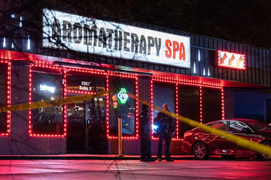 Law enforcement personnel are seen outside Aromatherapy Spa, where a person was shot and killed in Atlanta on March 16. Eight people were killed in shootings at three spas in Georgia that day.
