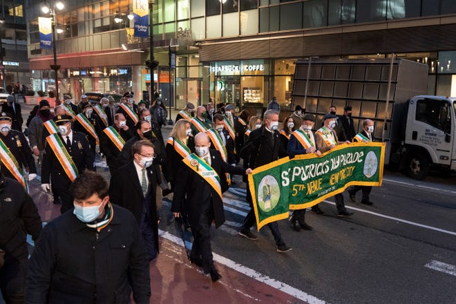 A smaller version of the St. Patrick's Day Parade marches up Madison Avenue Wednesday, March 17, 2021, in New York.