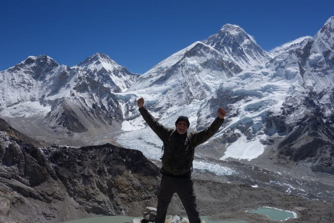 Bob Schooler at the summit of Kala Patthar in April 2017 with Mount Everest over his left shoulder.