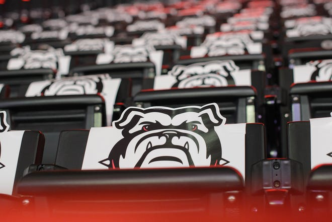 Bulldog cutouts rest over seats at a watch event for the NCAA women's basketball tournament selection show on Monday, March 15, 2021 at Stegeman Coliseum in Athens, Georgia. Many of the seats inside the venue are blocked off to reduce capacity and promote social distancing. (Julian Alexander for the Athens Banner-Herald)