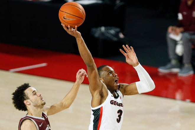 Georgia's Christian Brown (3) goes up to dunk the ball during a basketball game between Georgia and Montana in Athens, Ga., on Tuesday, Dec. 8, 2020. (Photo/Joshua L. Jones, Athens Banner-Herald)