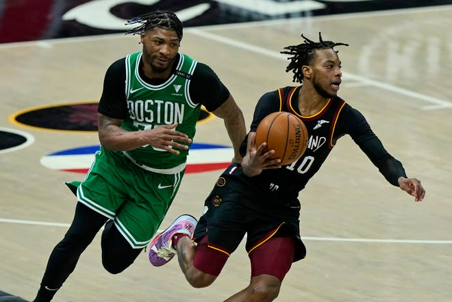 Cleveland Cavaliers' Darius Garland (10) drives against Boston Celtics' Marcus Smart (36) in the second half of an NBA basketball game, Wednesday, March 17, 2021, in Cleveland. [Tony Dejak/Associated Press]