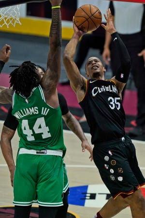 Cavaliers rookie Isaac Okoro (35) drives to the basket against Boston Celtics' Robert Williams III (44) during the Cavs' 117-110 victory Wednesday night at Rocket Mortgage FieldHouse. Okoro is known for his defense but has shown flashes of spectacular offensive ability  in recent games. [Tony Dejak/Associated Press]