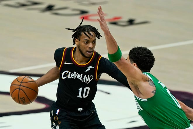 Cavaliers guard Darius Garland (10) is growing more comfortable in his role directing the team from his position at point guard. [Tony Dejak/Associated Press]