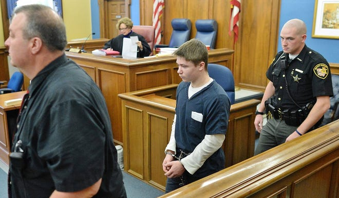 Gavon Ramsay is escorted by a sheriff's deputy in November 2018 prior to entering a no-contest plea for the murder of his neighbor.