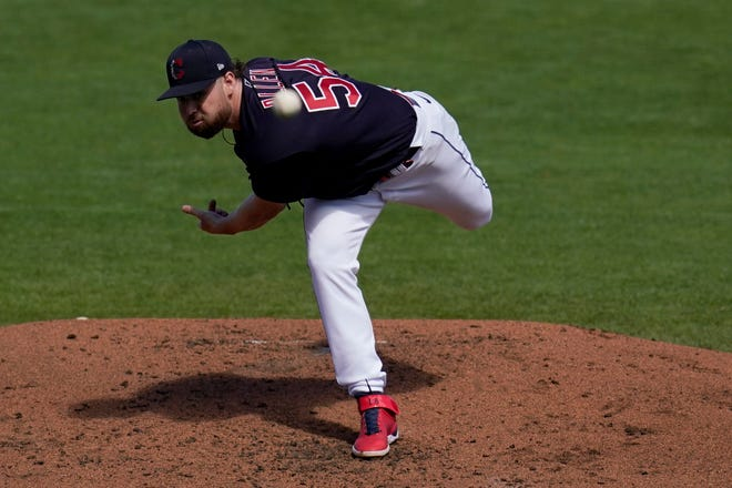 Cleveland Indians starting pitcher Logan Allen throws against the Oakland Athletics during the second inning of a spring training baseball game Monday, March 15, 2021, in Goodyear, Ariz. (AP Photo/Ross D. Franklin)