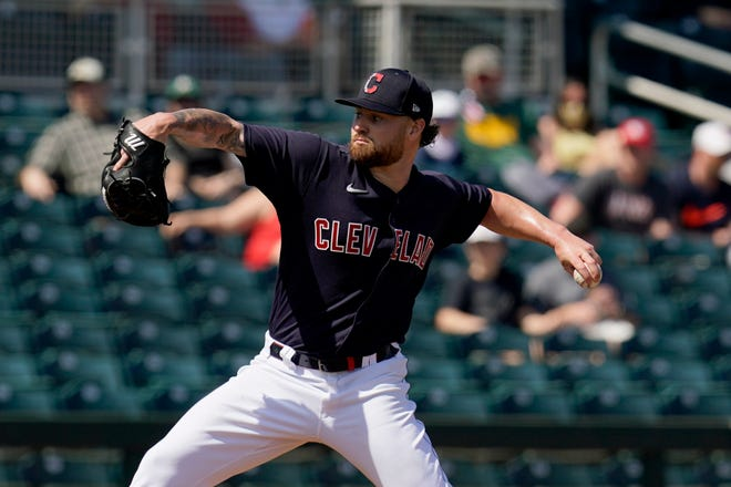Cleveland starting pitcher Logan Allen is forcing his way into the conversation to make the Opening Day rotation with a strong spring showing. [Ross D. Franklin/Associated Press]
