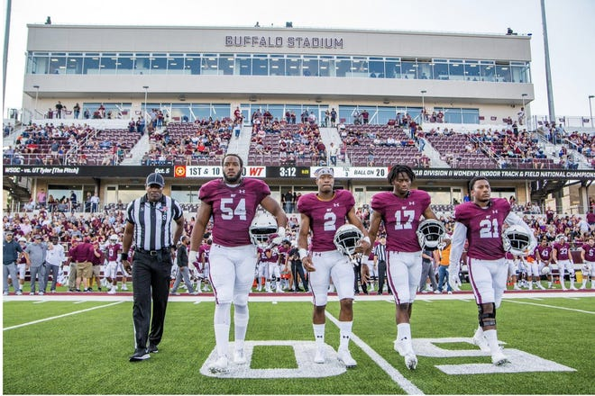 West Texas A&M captains walk to midfield for the pregame coin toss before the game against Western New Mexico on Saturday, Sept. 28, 2019 at Buffalo Stadium in Canyon, Texas. [John Moore/for the AGN Media Archives]
