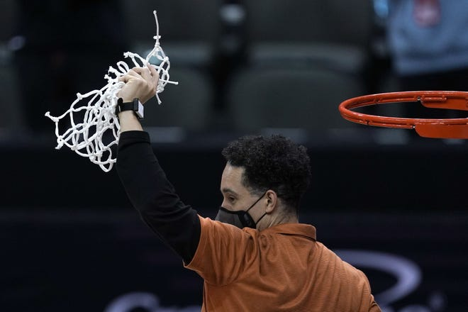 Texas head coach Shaka Smart cuts down the net after winning the Big 12 Tournament Championship NCAA college basketball game against Oklahoma State in Kansas City, Mo, Saturday, March 13, 2021. Smart joins the On Second Thought podcast this week to discuss Texas' NCAA opener against Abilene Christian.