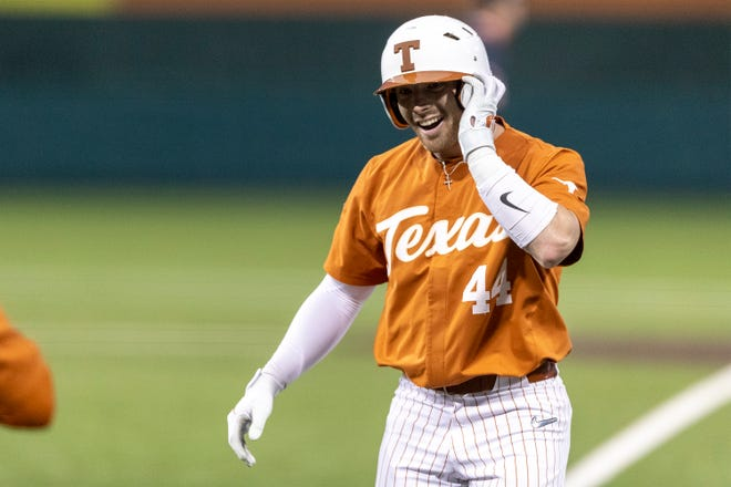 Texas senior Austin Todd celebrates a base hit against Sam Houston in Austin on March 9, 2021. Todd will miss the rest of the 2021 season with a shoulder injury.