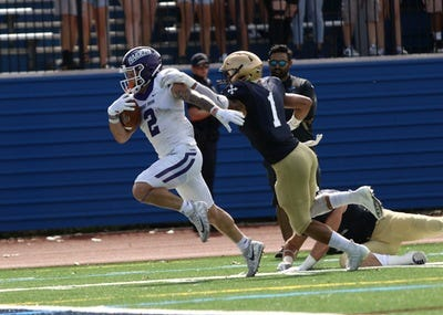 John Petruccelli (2) rushed for 69 yards in the Purple Raiders' 37-14 win at John Carroll in September 2019.
