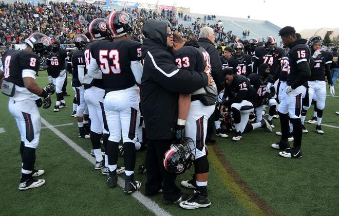 Sherman McBride consoles Aliquippa's Kiyon Fooks at the end of the 2015 PIAA championship game. McBride, a former Aliquippa assistant, has been hired as Ambridge's head football coach.